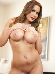 Pictures of Alanah Rae posing and stripping
