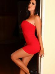 Stunning babe Summer shows off her perfect curves in a tight red dress