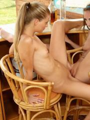 Horny girls Tina and Cayenne enjoy licking and fisting each other at the bar