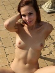 Redhead girl Candy Sweet masturbates with her jump-rope outside