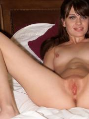 Brunette cutie Angelina gets naked and masturbates in bed