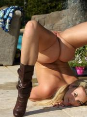 Mia Malkova waters her garden before tending to her own budding flower