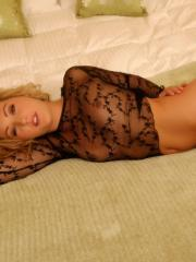 Pictures of Sarah Peachez teasing in a sheer top on the bed