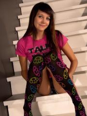 Andi Land teases in her panties and long socks