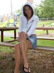 Ann Angel shows off her sexy legs and ass at a park