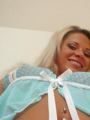 Ann Angel takes some sexy pics of herself in blue lingerie
