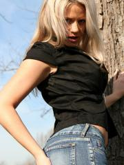 Blonde teen Ann Angel shows cleavage in her sexy jeans