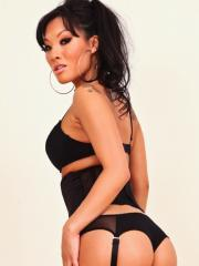 Pictures of sexy Asian Asa Akira posing in black lingerie and stockings.