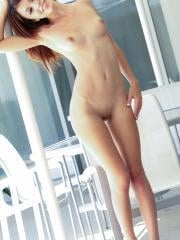 Beautiful girl Ashley Doll gives a striptease in her sexy silver outfit