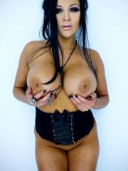 Pictures of Audrey Bitoni showing off in a corset