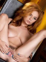 Redhead babe Ashley Graham gets her pussy warmed up for you