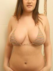 Pictures of Abi Louise soaping up her big boobies in the shower