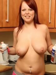 Pictures of busty redhead Ruby Daniels getting messy in the kitchen