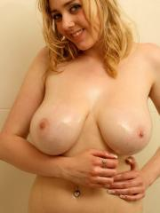 Pictures of a sweet blond oiling her huge boobs up