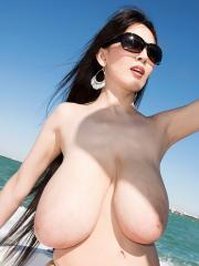 Busty asian babe Hitomi goes wild on a boat