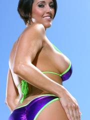 Dylan Ryder rocks her shiny purple bikini by the pool