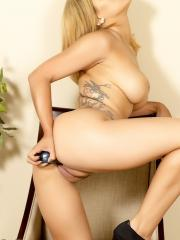 Briana Lee strips out of her long black dress to masturbate