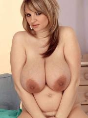 Busty blonde Kelly Kay exposes her huge natural boobs