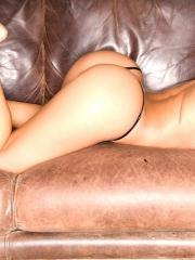 Carmen shows off her thong on the leather couch