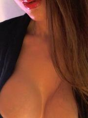 Hot cam girl Wanda Milano gets topless in a business suit
