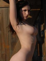 Carlotta Champagne shows off her long legs and big boobs in an old western ghost town