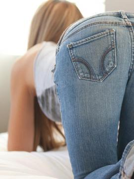 Cassidy Cole removes her tight blue jeans to expose her incredible tight body