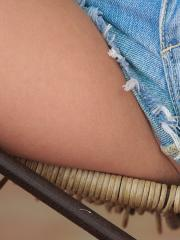 Catie Minx gets cheeky as she wriggles out of her tight daisy dukes