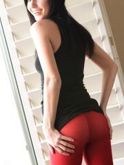 Catie Minx pulls down her sexy red tights over her tight ass ready for some debauchery