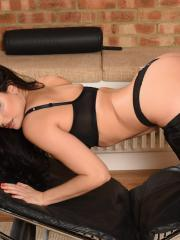 Charlotte Springer shows you her big round boobs in black pants and a thong