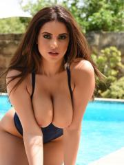 Busty babe Charlotte Springer exposes her big boobs by the pool
