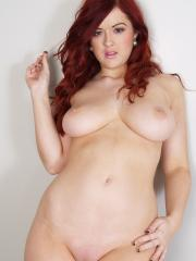 Hot redhead Rosie Jaye oozes out of her sexy black bustier
