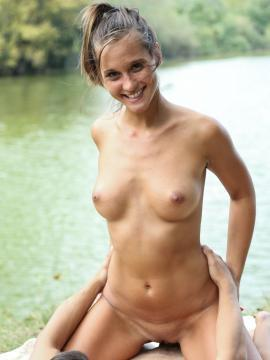 Horny coed having sex by the lake