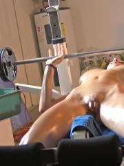 Beautiful redhead Victoria Nelson does her bench presses completely naked