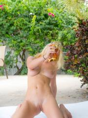 Gorgeous blonde Christa gets completely naked and has fun with the honey