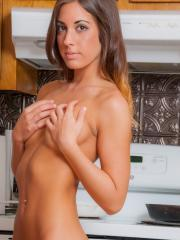 Beautiful girl Bella Luna strips for you in the kitchen