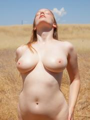 Beautiful redhead Julia Fleming invites you into her field of dreams