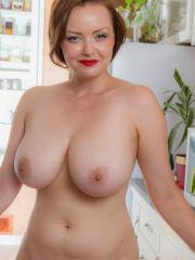 Busty girl Natasha Dedov strips naked for you in the kitchen