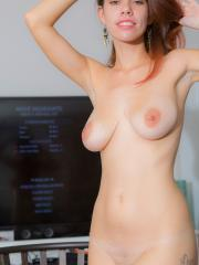 Busty amateur Marina Ross shows off her big natural tits and round ass