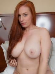 Busty redhead Titania gets naekd for you on the bed