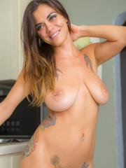 Brunette hottie Veronica Buleau makes you a special treat in the kitchen