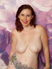 Busty brunette babe Mary Helen shows you her flowers