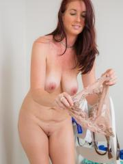 Redhead hottie Andy Adams lets you watch her changing clothes