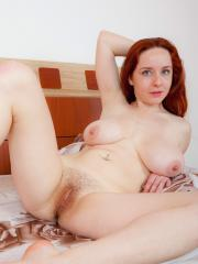 "Busty redhead Sara Nikol says ""Hello"" with her huge boobs"