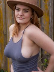 Busty redhead Dallin Thorn strips naked in the back yard