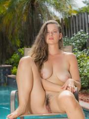 Busty hottie Lillie Varga gets naked for you by the pool