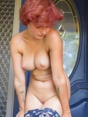 Redhead girl Naomi Cord strips for you by the door