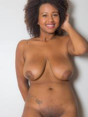Busty ebony babe Whitney Williams strips out of her long skirt