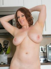 Busty girl Maggie Green strips for you in the kitchen