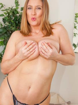 Busty redhead Jenny Baxter shows you her big natural boobs
