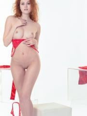 Redhead beauty Heidi strips out of her red lingerie